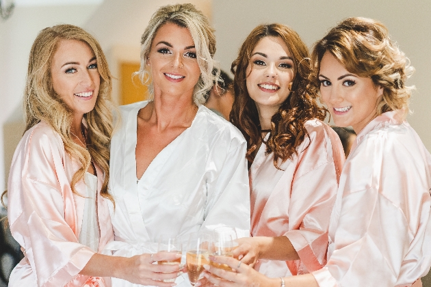 A beautiful bride and her bridesmaids getting ready for the big-day