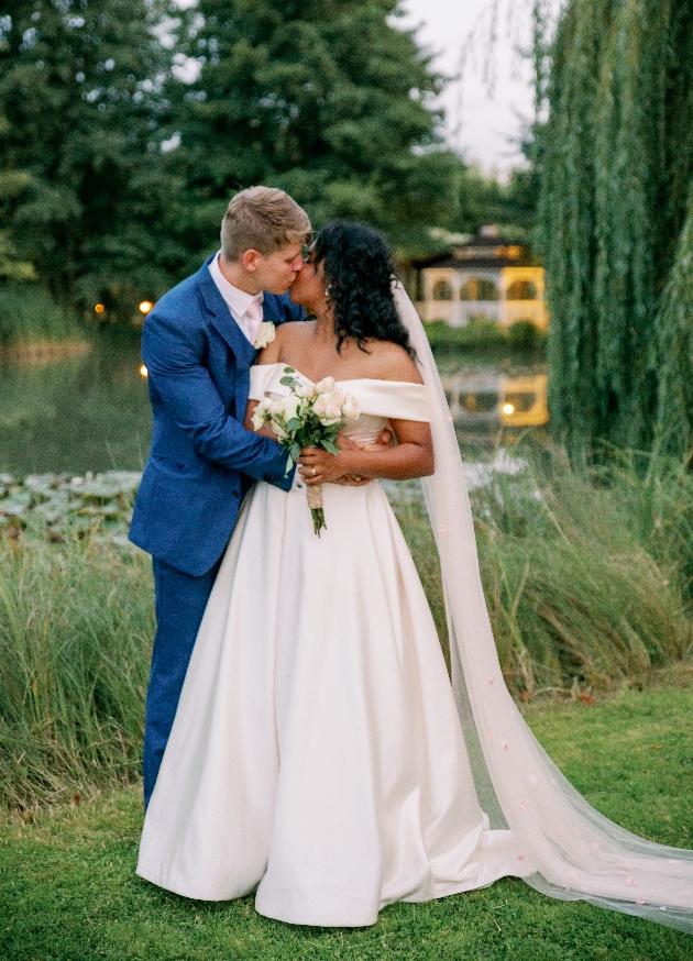 Couple kiss infront of lake
